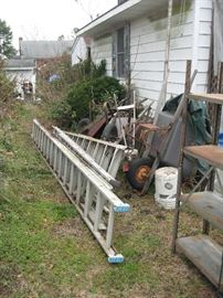 Ladders and old wheel barrows, and carts.