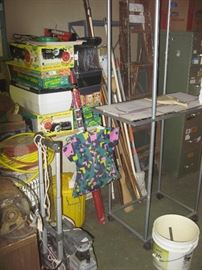 A plant seeding rack along with seed starting supplies.