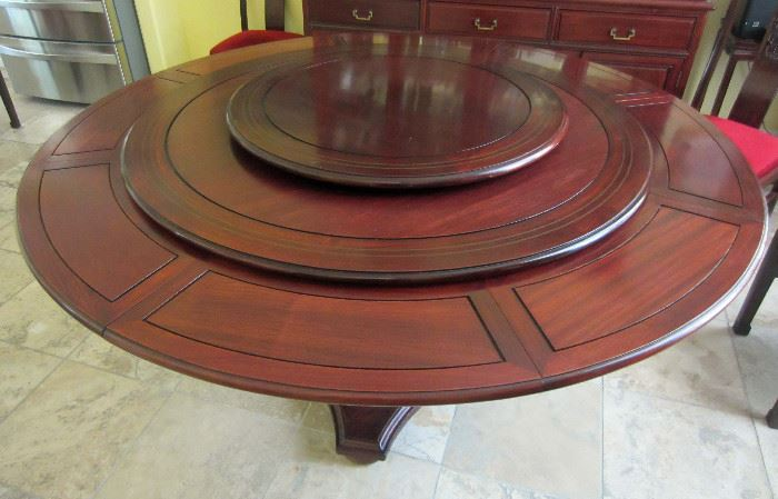 Very unique ROSEWOOD table purchased in England with Lazy -Susan accessory on top.  The outer sections fold and slide under the top for the smallest size, and when expanded the center piece rotates down to make the large diameter table.