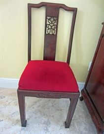 One of eight rosewood side chairs