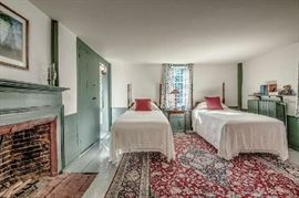 Pair of twin beds and fine oriental roomsize carpet