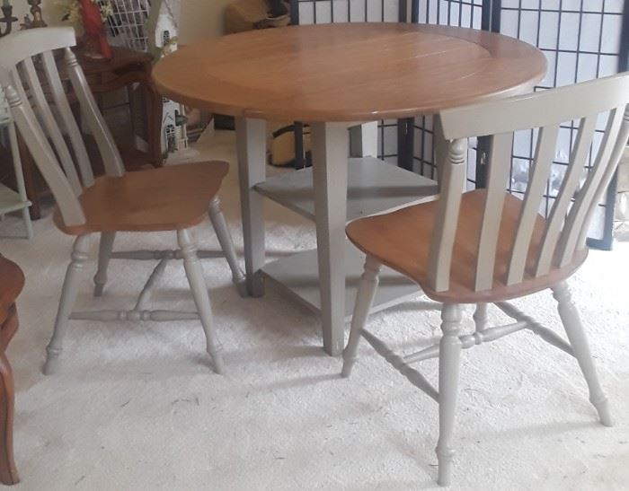 Nice modern dropleaf table and 2 chairs. Solid.