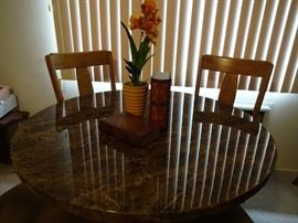 Round pedestal table with four chairs, upholstered seats