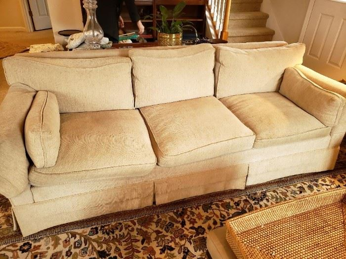 Neutral Comfortable Attractive Down Stuffed Sofa.
