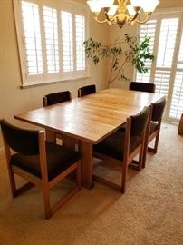 Mid-Century Mission Dining set. 6 chairs and a retractable leaf. Fantastic piece of furniture.