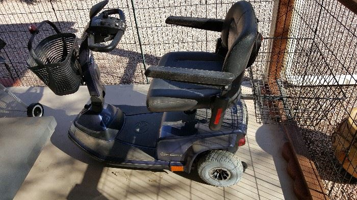 3-wheel battery-operated scooter with front and rear baskets