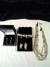 two pairs of earrings,one breast cancer survivor awareness bracelet, one pearls and gold necklace https://ctbids.com/#!/description/share/125107