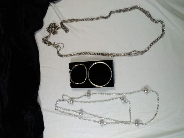 2 extra long silver style necklaces and two bangle bracelets https://ctbids.com/#!/description/share/125111