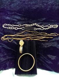 Lorus wrist watch, gold stretch bracelet, gold multi-strand necklace, gold linked belt https://ctbids.com/#!/description/share/125116
