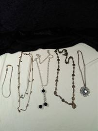 lot of 5 silver style necklaces , one with turquoise style pendant https://ctbids.com/#!/description/share/125122