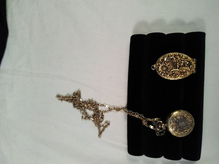 2 vintage gold style necklace watches , one Vogue, 1 baroness with chain       https://ctbids.com/#!/description/share/125131