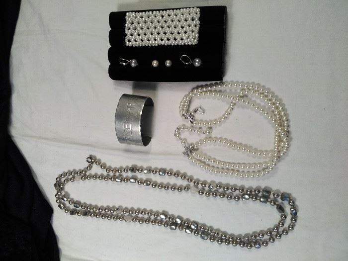two pearl style necklaces, one pearl style bracelet, one engraved metal cuff , two pairs of pearl style ear  https://ctbids.com/#!/description/share/125153
