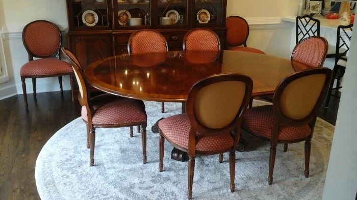 Henredon dining table with two leaves and pads. Purchased at Hollbergs Fine Furniture. Eight chairs sold separately from the table.