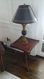 Theodore Alexander table lamp. Antique leather top piecrust table.
