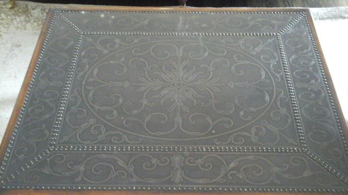 Top of Theoadore Alexander cocktail table. Etched brass panel.