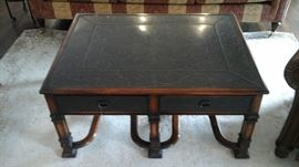 Theodore Alexander cocktail table. With leather top pull outs on both sides and etched brass panels on top and on front of drawers.