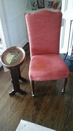 Painted oval side table. Upholstered side chair.