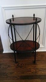 Theodore Alexander lamp table oval laurel veneer and verdigris brass on castors.