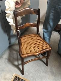 One of 8 cane chairs Tiger maple
