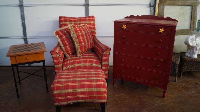 game table, chair with ottoman, red chest of drawers