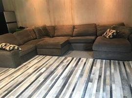 Gorgeous cowhide rug from crate and barrel 9 x 12 And Large sectional with storage ottoman. Removable and washable cushion covers!