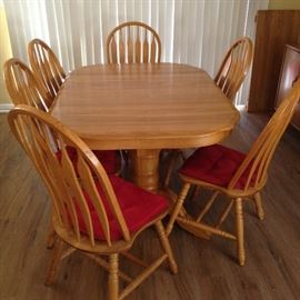 """The OakTree Furniture Co.  Solid Oak Table (w/added leaf), Double Pedestal Base and 6 Colonial Style Matching Chairs. (30""""h x 60""""w x 42.5""""d.  Leaf:  18""""w x 42.5""""d):  $600.00"""