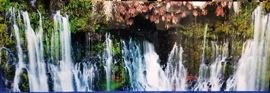 Beautiful waterfall photograph on plexiglass in the style of Peter Lik. Signed bottom right.