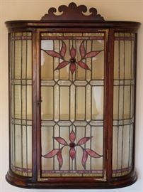 Unusual hanging curved oak cabinet with leaded glass.