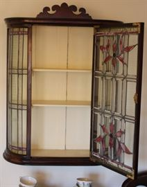 Opened wall hanging stain glass cabinet.