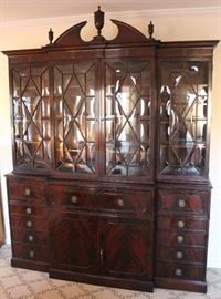 Very imposing Chippendale Flame Mahogany Secretary Breakfront with burl and shell inlay. Note the blown glass in the cabinet doors.