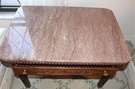 Close up of the marble top on the Victorian era base.