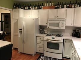 Kitchen appliances, Refrigerator ,range, microwave and dishwasher.