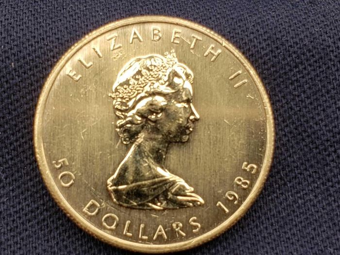 #7: 1985 $50 Maple Leaf 1oz. Fine Gold Coin 1985 $50 Maple Leaf 1oz. Fine Gold Coin