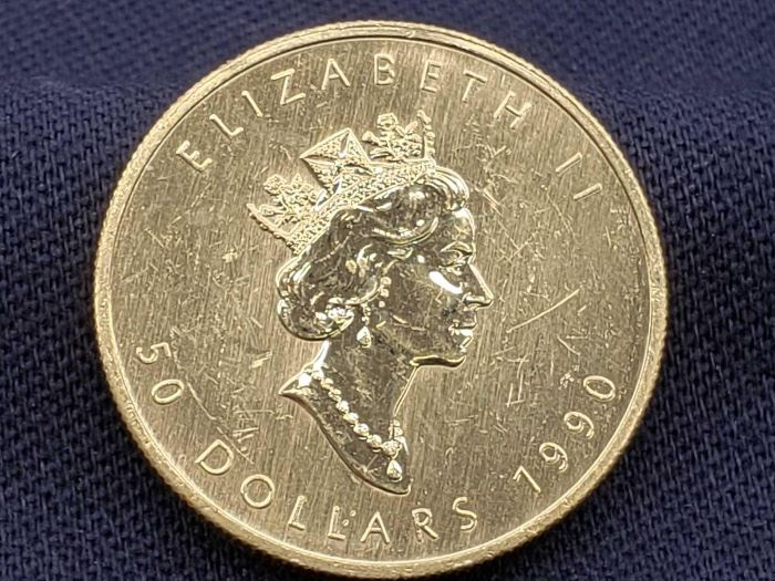 # 11 1990 $50 Maple Leaf 1oz Fine Gold Coin 1990 $50 Maple Leaf 1oz Fine Gold Coin