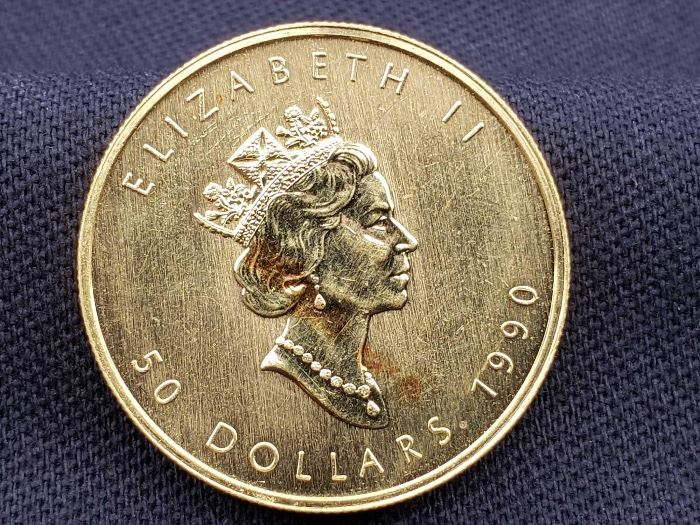 12 1990 $50 Maple Leaf 1oz. Fine Gold Coin 1990 $50 Maple Leaf 1oz. Fine Gold Coin