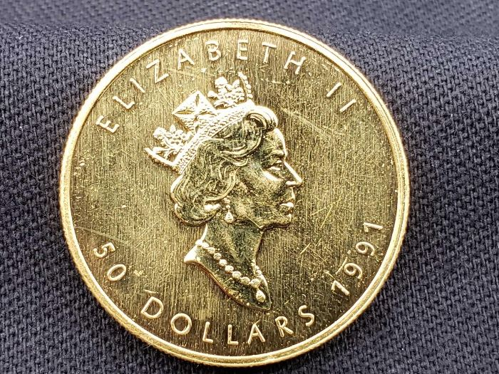 #13 1991 $50 Maple Leaf 1oz. Fine Gold Coin 1991 $50 Maple Leaf 1oz. Fine Gold Coin