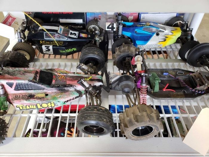 # 213 4 Electric RC Cars, Team Losi, Team Associated, and Others 4 Electric RC Cars, Team Losi, Team Associated, and Others