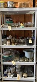 # 267 Five shelves of miscellaneous glassware and silverware Five shelves of miscellaneous glassware and silverware