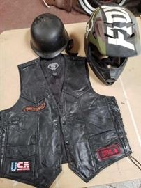 # 280 Fox Helmet Size M, Small Helmet, and Leather Vest with Patches Fox Helmet Size M, Small Helmet, and Leather Vest with Patches