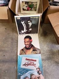 # 403 Box of Records, Eddie Murphy, Cheech and Chong, Lynard Skynyrd, and Classic Rock and the like Box of Various Cds , Mariachi, and the like, 8 Barious DVDs