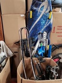 # 516 2 Boxes Of Miscellaneous Bike parts, Seats, Forks, Bike Stands and Snow Sled 2 Boxes Of Miscellaneous Bike parts, Seats, Forks, Bike Stands and Snow Sled