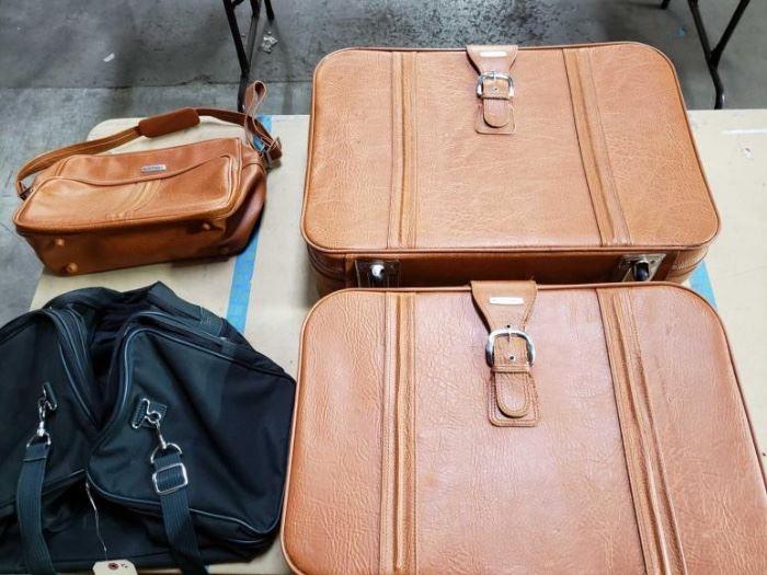 # 600 2 Suitcases, 2 Duffel Bags 2 Suitcases, 2 duffel bags