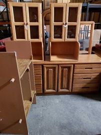 # 715 Approximately 6 Peices of Miscellaneous Furniture Shelving mears dressers and cabinets all for one money