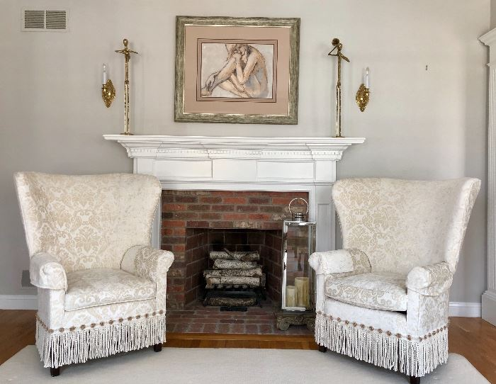 All furnishings are in excellent condition! Here is a pair of wingback chairs with fringed accent.
