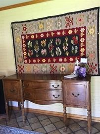Stunning rug from Romania. Federal style buffet.