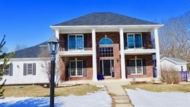A wonderful home with an attached home on Grand River plus a pool.