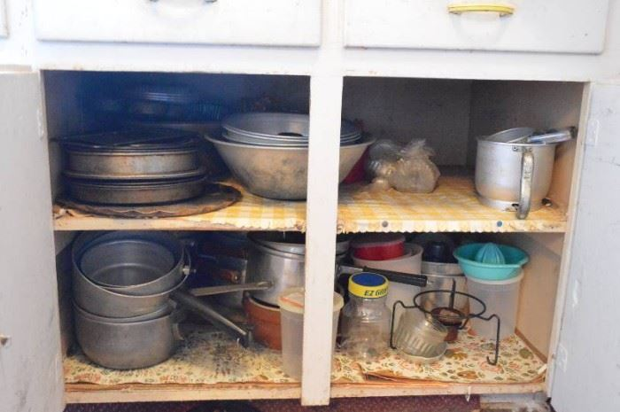 All kitchenware dishes in lower cabinets  two d ...