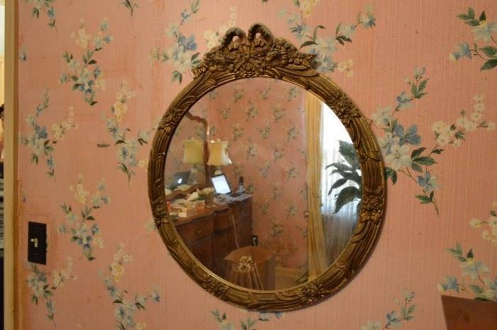 Ornate round mirror