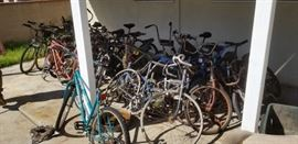 A bicycle collection of all shapes and sizes...most need some work.