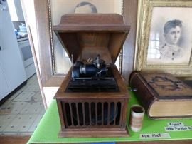 Antique Thomas Edison Amberola 30 in good working order. Come with a box of blue amberol record cylinders.